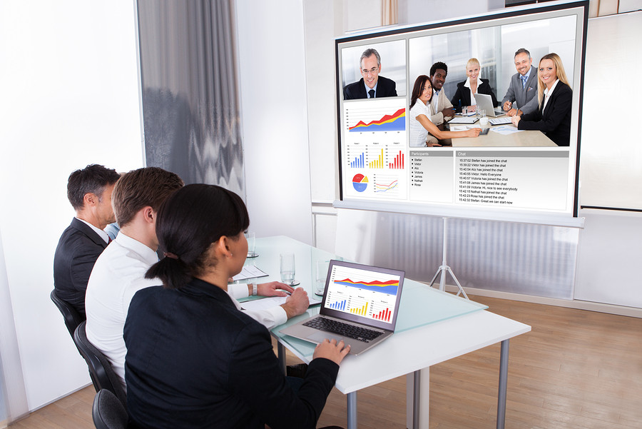 Group Of Businesspeople In Video Conference At Business Meeting
